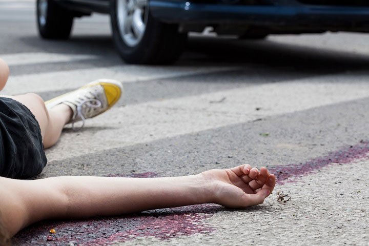 Close-up of unconscious woman at accident scene